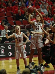 Sienna Durr, 24, goes inside for one of her 24 points for Grinnell in their opening 70-51 win in the Class 4A quarterfinals at state against Mason City.