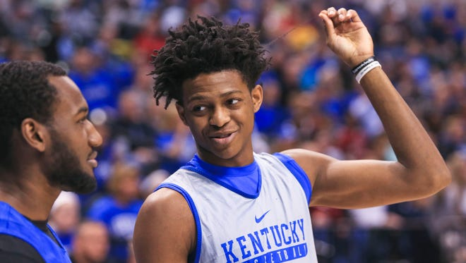 Kentucky's De'Aaron Fox twirls his hair while talking with teammate Dominique Hawkins during practice Thursday afternoon at Bankers Life Fieldhouse before the start of the team's NCAA tournament play. The team takes on Northern Kentucky Friday evening at 9:40 pm.