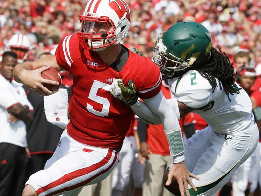 Wisconsin's Tanner McEvoy is tackled by South Florida's Jamie Byrd on a run during the first half of an NCAA college football game, Saturday, Sept. 27, 2014, in Madison, Wis. (AP Photo/Morry Gash)