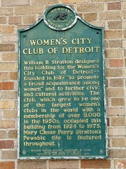 This historical plaque hangs on the Women's City Club