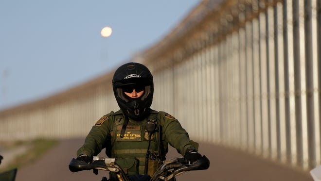 In this June 22, 2016 photo, a Border Patrol agent rides a vehicle along a border structure in San Diego. Lawmakers, union leaders and polygraph experts contend that the use of lie detectors in the application process has gone awry and that many candidates are being subjected to unusually long and hostile interrogations, which some say can make people look deceptive even when they are telling the truth. (AP Photo/Gregory Bull)