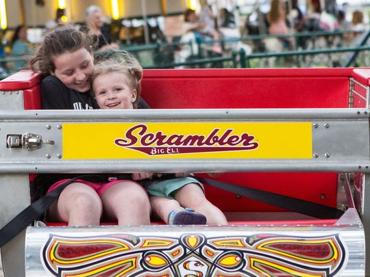 Children ride the Scrambler ride at the Hebron Fireman's Carnival. The annual carnival continues through June 29.
