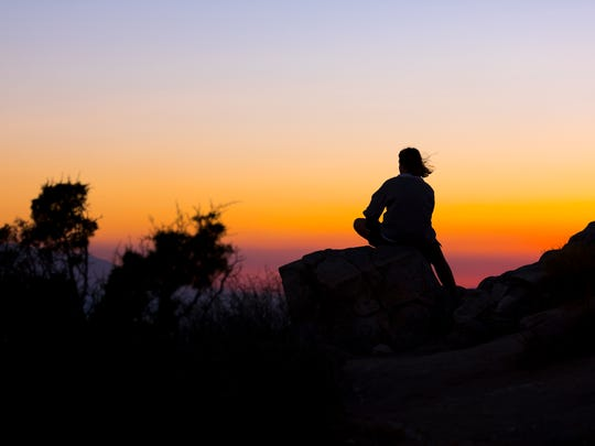 A visitor takes in a sunset at Keys View in Joshua Tree National Park.