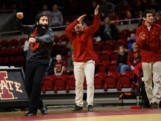Iowa State Associate Head Coach Mike Zadick, left, shouts out to Jarrett Degen who wrestles Fresno State's Khristian Olivas during their 149lb match on Friday, Feb. 9, 2018, in Ames. Degen lost the match 14-15 but Iowa State would go on to win the dual 26-22.