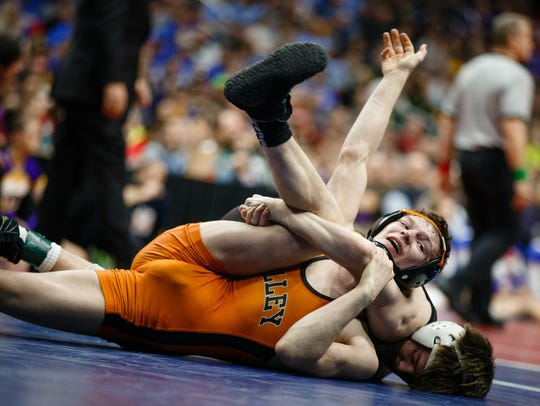 Valley's Nick Oldham wrestles Caleb Rathjen of Ankeny during their class 3A 113 pound championship match at Wells Fargo Arena on Feb. 17 in Des Moines.