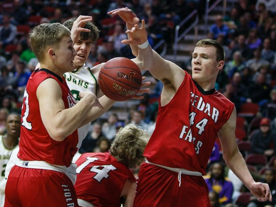 Iowa City West's Patrick McCaffery (22) fights for a rebound with Cedar Falls' Jack Campbell (44) during the first half of their 4A state basketball championship game on Friday, March 9, 2018, in Des Moines.