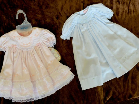 Baby gowns sold at Village Boutique on Creswell Lane
