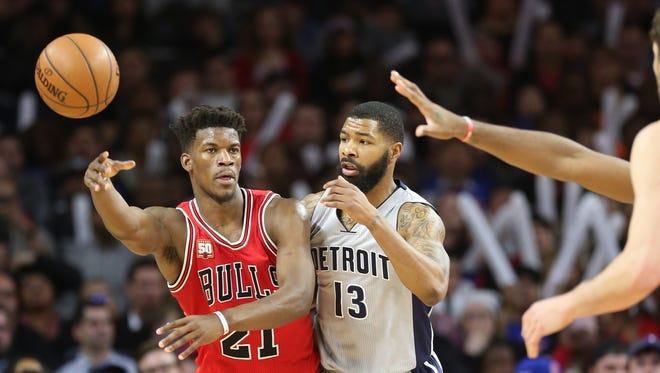 Pistons forward Marcus Morris defends against Bulls guard Jimmy Butler during the third period of the Pistons' loss Monday at the Palace.