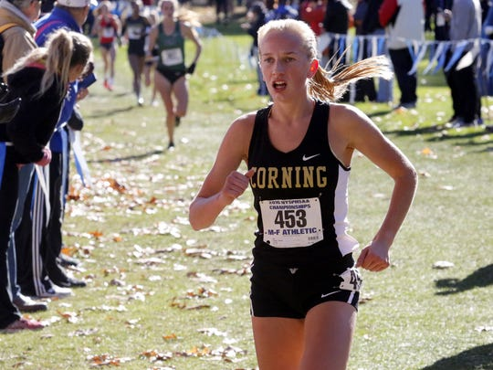 Corning's Jessica Lawson competes in the girls Class A race Saturday at the New York State Public High School Athletic Association cross country championships at Chenango Valley State Park. Lawson finished third.