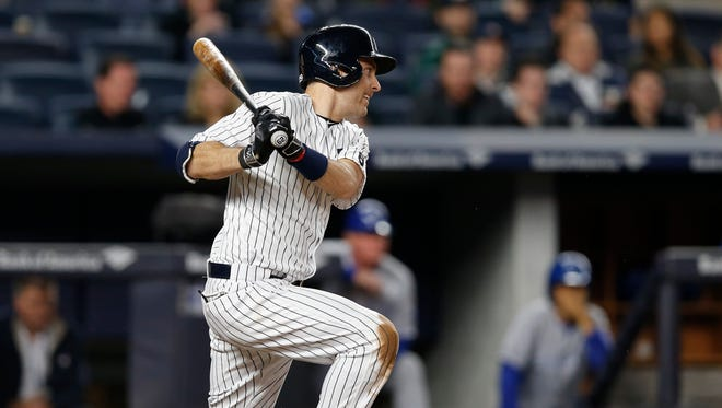 New York Yankees Dustin Ackley watches a seventh-inning RBI single in a baseball game against the Kansas City Royals at Yankee Stadium in New York, Tuesday, May 10, 2016.