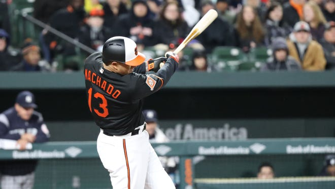Manny Machado of the Orioles connects on a three-run home run against the Yankees at Oriole Park at Camden Yards in Baltimore.