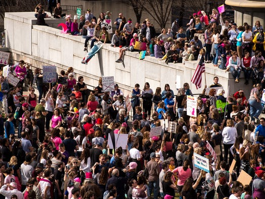 Demonstrators gather in Public Square during a march
