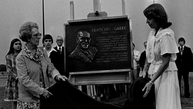 In May of 1978, Mrs. Herschel Greer, left, and daughter unveil a plaque dedicating the Nashville Sounds baseball stadium to the late Herschel Greer. The dedication took place prior to the game.