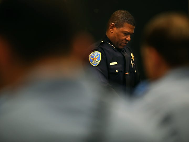 San Francisco Police Chief Bill Scott looks on during