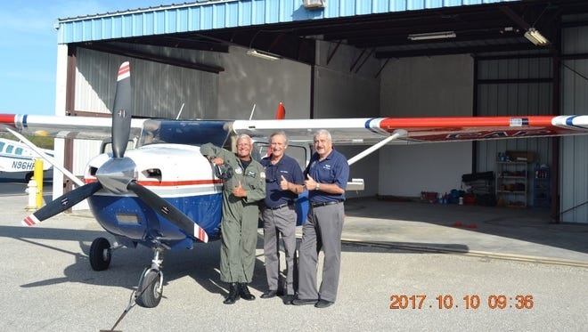 From left: Bob Boone, Dave Dumas and Bob Corriveau back on the job at the temporary hangar.