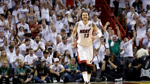 Miami Heat's Mike Miller (13) reacts after scoring