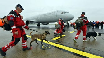 Some of the 62 members of the Dutch Urban Search and Rescue team get ready to leave with their tracker dogs for Nepal to help search for victims after the earthquake at Eindhoven Airport, on April 26, 2015.