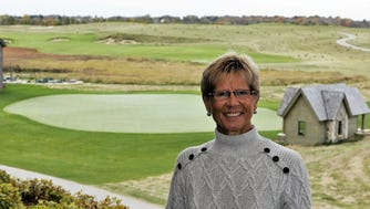 Mimi Griffin stands at the clubhouse patio at Erin Hills golf course. She is CEO and founder of MSG Promotions, the major event marketing company in charge of corporate hospitality for the 2017 U.S. Open Championship to be held at Erin Hills.