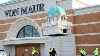 Construction workers prepare to place a Von Maur signature cupola on the store being built at The Corners of Brookfield retail/residential development. The 150,000-square-foot store is on schedule to open in April. It will be the first Von Maur in Wisconsin