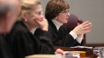 Justice Jaynee LaVecchia, right, has written the latest affordable-housing decisions for the state Supreme Court.