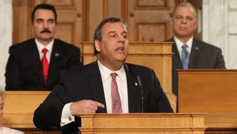 Governor Christie delivering the State of the State speech in January. Behind him, Assembly Speaker Vincent Prieto, (left) and state Senate President Stephen Sweeney.