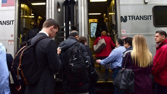 Commuters board an NJ Transit train heading to Secaucus Junction at the Broadway station in Fair Lawn on Thursday.