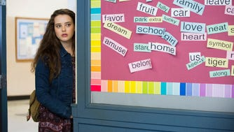"""This image released by Netflix shows Katherine Langford in a scene from the series, """"13 Reasons Why,"""" about a teenager who commits suicide."""
