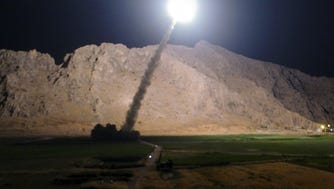 In this file photo released by the Iranian state-run IRIB News Agency on Monday, a missile is fired from city of Kermanshah in western Iran targeting the Islamic State group in Syria.