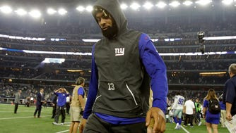 New York Giants wide receiver Odell Beckham Jr. (13) leaves the field after the game against the Dallas Cowboys at AT&T Stadium.
