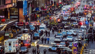 Law enforcement officials work following an explosion near New York's Times Square on Dec. 11, 2017. Police said a man with a pipe bomb strapped to him set off the crude device in a passageway under 42nd Street between Seventh and Eighth Avenues.