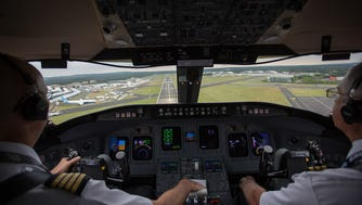 Operating for Bombardier, a company CRJ-900 lands at the 2014 Farnborough Airshow in the England on July 11, 2014.