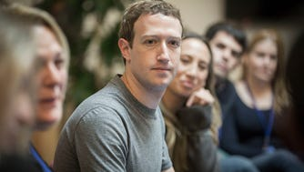 Facebook CEO Mark Zuckerberg speaks to guests at Facebook headquarters in Menlo Park, California on Tuesday, January, 31, 2017. Over a year later, the Facebook co-founder faced a crisis over its handling of a large-scale abuse of its users' personal info.