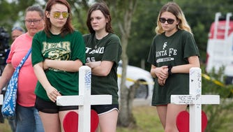 Santa Fe High School students stop at the makeshift memorial outside Santa Fe High School in Texas after the latest school shooting. Columnist Joe Phalon says these students are part of the Lockdown Generation that isn't going away anytime soon.