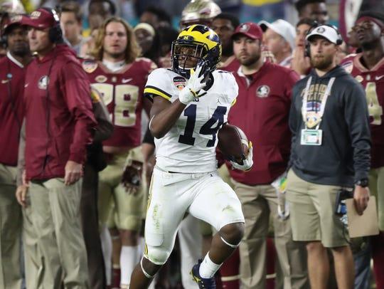 Michigan's Josh Metellus runs back a blocked extra
