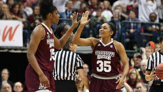 Mississippi State Lady Bulldogs center Teaira McCowan (15) and forward Victoria Vivians (35) celebrate during a game.