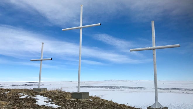 Priest Butte, located near Freezout Lake between Choteau and Fairfield on Highway 89, is topped with three crosses in honor of three priests who founded a Jesuit mission among the Blackfeet Tribe in 1859.