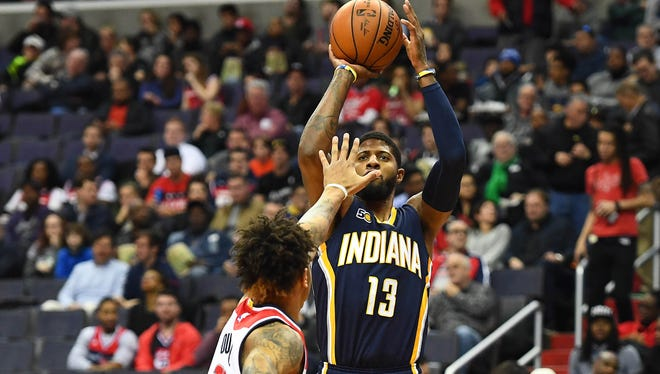 Dec 28, 2016; Washington, DC, USA; Indiana Pacers forward Paul George (13) shoots over Washington Wizards forward Kelly Oubre Jr. (12) during the first half at Verizon Center.