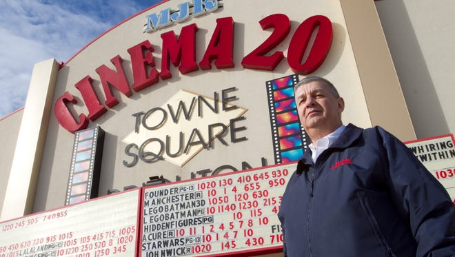 Dennis Redmer, vice president of operations and construction for MJR Digital Cinemas, will install new wider recliner seats in all the theaters of the Towne Square Brighton Cinema 20.