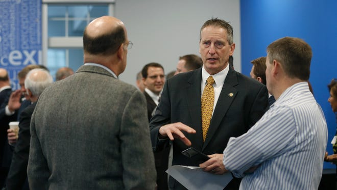 Robert Duffy chats with attendees before a Chamber Business Rounds roundtable focused on finance February, in the Five Star Bank CityGate Branch.