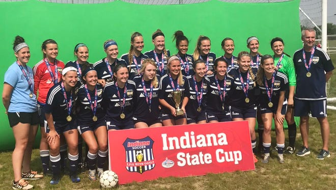 The Sporting Southern Indiana U18 travel soccer team poses with the State Cup trophy.