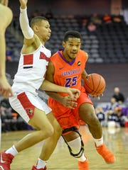 University of Evansville's Duane Gibson (25) drives against Illinois State's Elijah Clarance (1) as the University of Evansville plays Illinois State on West Side Day at the Evansville Ford Center Saturday, December 23, 2017.