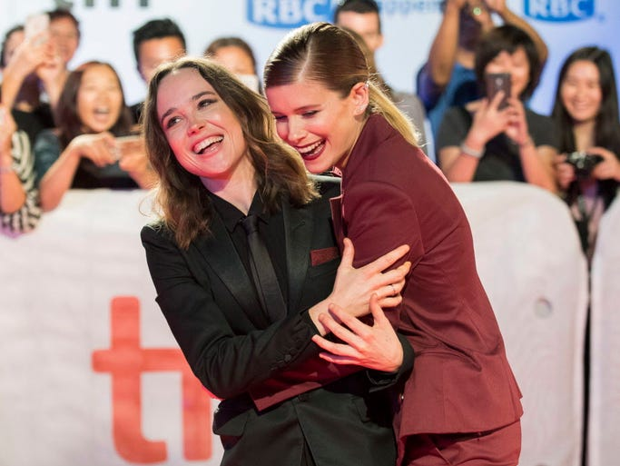 Actresses Ellen Page, left, and Kate Mara attend the