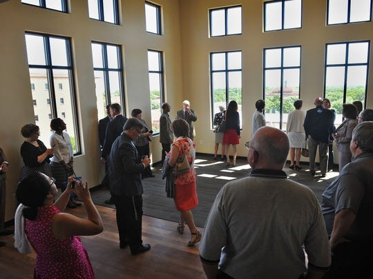 Visitors tour MSU's new Legacy Hall dormitory when it opened last August. The residence hall will be home to 500 students and features a conference room, an apartment for faculty in-residence, a community learning center and recreation area.