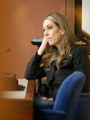 District Court JudgeLuis Aguilar of the 243rd District ordered that a key state prosecutor, El Paso Assistant District Attorney Denise Butterworth be recused from trying a triple murder case after defense lawyers argued that she became a witness during the investigation. Butterworth was disqualified Thursday from serving as the lead prosecutor in the trial of LuisJavier Solis-Gonzalez, who is charged with one count of capital murder of multiple persons. Solis-Gonzalez is accused in the 2012 slayings of his estranged wife, Marysol Saldivar, 34; her boyfriend, Eric DeSantiago, 42; and her 13-year-old daughter Cassaundra Holt. Here Butterworth sits at the witness stand as she waited for questions from Defense lawyer Joe Spencer, (not shown.)