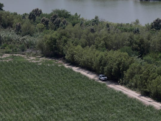 In this July 24, 2014, file photo, a Customs and Border Protection vehicle patrols on the Texas border near the Rio Grande in Mission, Texas.