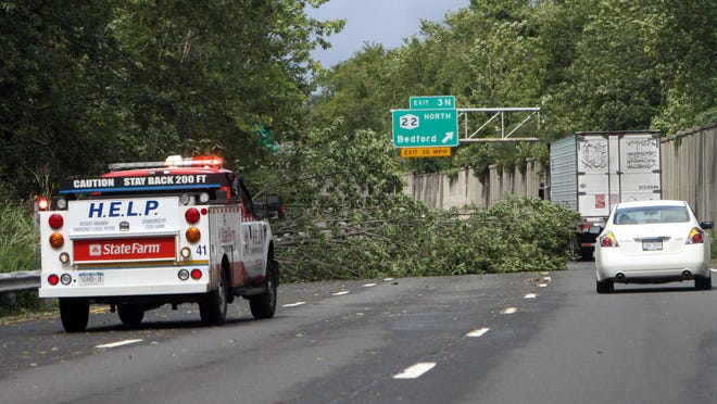 A HELP truck blocks two lanes of northbound Interstate 684 just before Exit 3 in Armonk after a tree fell onto the highway during Tropical Storm Irene on Aug. 28, 2011.