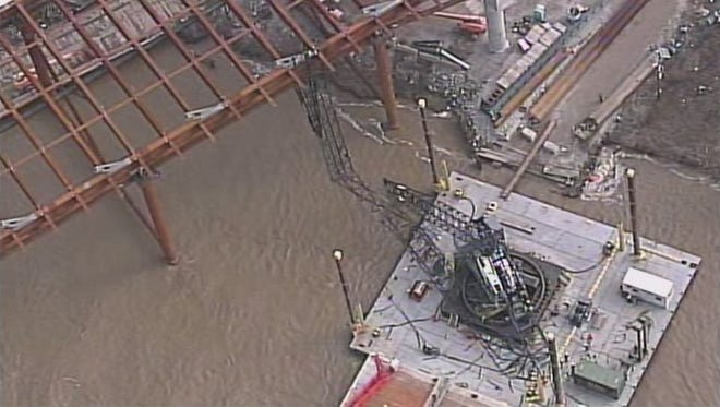 A crane collapsed Friday near the East End bridge worksite.