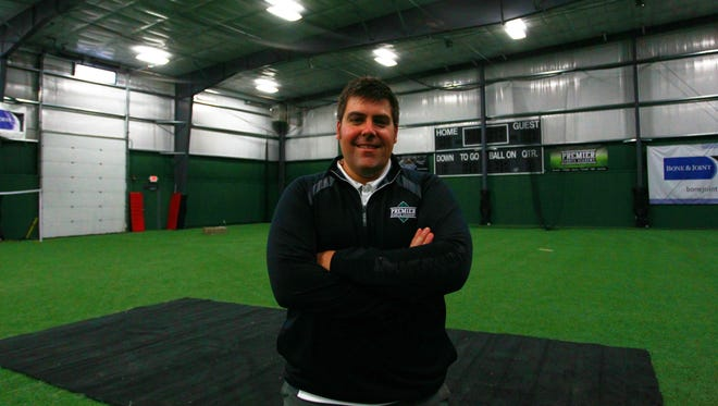 Owner Eric Greening poses for a photo Thursday inside Premier Sports Academy in Weston.