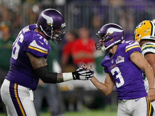 Minnesota Vikings kicker Blair Walsh, right, celebrates with teammate Alex Boone, left, after kicking a 46-yard field goal during the first half of an NFL football game against the Green Bay Packers Sunday, Sept. 18, 2016, in Minneapolis. (AP Photo/Andy Clayton-King)
