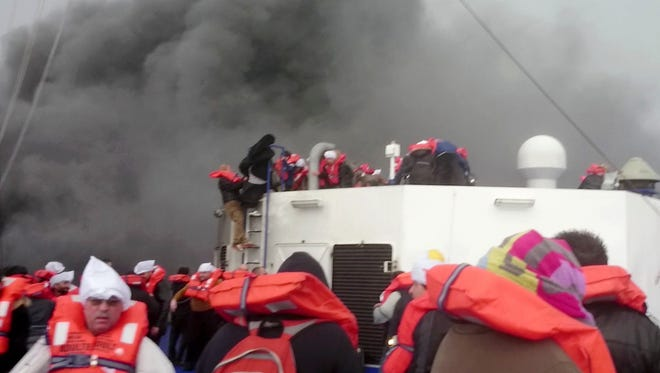 Passengers of the Italian-flagged ferry Norman Atlantic wait to be rescued after it caught fire in the Adriatic Sea.